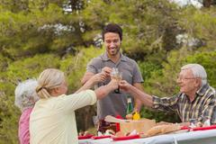 Family toasting each other at lunch - stock photo