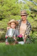 Mother and daughter gardening together Stock Photos