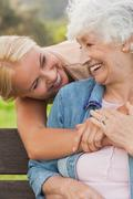 Elderly woman laughing with her adult daughter - stock photo