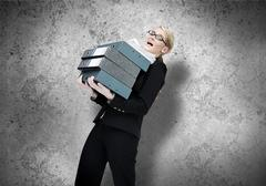 Businesswoman struggling with work load Stock Photos