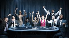 Stock Photo of Attractive group cheering at the casino