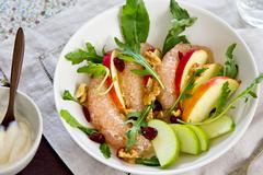 Apple with Pommelo and Walnut salad - stock photo
