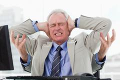 Stock Photo of Stressed businessman with four arms