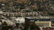 City spreads out at foothills Stock Footage