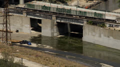 Mostly empty Los Angeles River aqueduct - stock footage