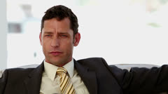 Businessman looking anxious Stock Footage