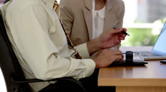 Business man and woman speaking together - stock footage