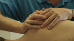 Physiotherapist Massages Patient Top Shoulder - 25FPS PAL Stock Footage