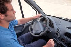 Van driver left hand drive vehicle. Stock Photos
