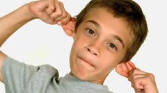 Little boy wincing Stock Footage