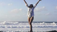 Happy, excited woman standing by the sea, super slow motion, shot at 240fps HD Stock Footage