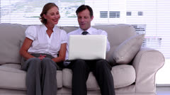 Businessman showing colleague something on laptop Stock Footage