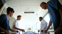 Multi Ethnic Nursing Staff Pushing Patient Bed Hospital Stock Footage