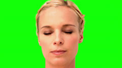 Woman showing her anger on green screen - stock footage