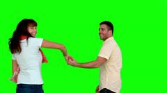Cute couple dancing on green screen Stock Footage