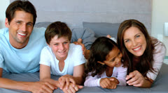 Family lying on a bed Stock Footage
