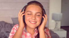 Girl listening to music with headphones Stock Footage
