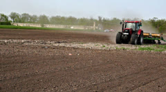 Tractor and seeder at the field Stock Footage