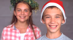 Smiling siblings with christmas hat Stock Footage