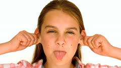 Girl sticking out her tongue Stock Footage