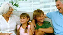 Children with grandparents on the couch Stock Footage