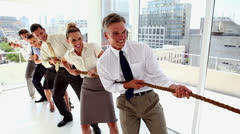 Business people pulling a rope together Stock Footage