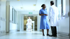Stock Video Footage of Wheelchair Patient Corridor Busy Hospital