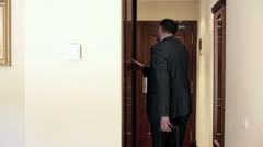 Stock Video Footage of Young businessman with case leaving the hotel room