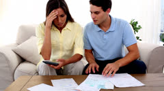 Stressed couple because of bills to pay - stock footage