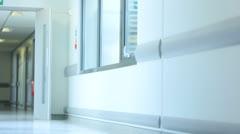 Medical Staff Talking Senior Female Hospital Patient - stock footage