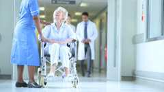 Older Patient Ethnic Nurse Hospital Corridor - stock footage