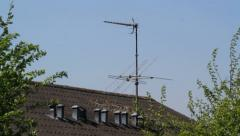 Faulty TV antenna on roof swinging in a fresh breeze Stock Footage