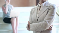 Portrait of smiling businesswoman standing on stairs, interior Stock Footage