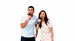 Friends dancing and singing on white background Stock Footage