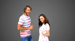 Two friends dancing together on grey background Stock Footage