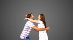 Couple meeting again on grey background - stock footage