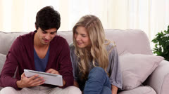 Couple using tablet together - stock footage