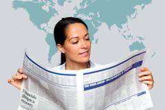 Businesswoman reading a financial newspaper Stock Photos