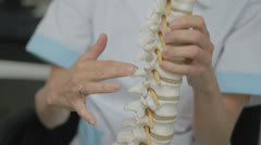 Chiropractor Explaining the Spine - 25FPS PAL Stock Footage
