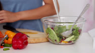 Woman cooking together in the kitchen Stock Footage