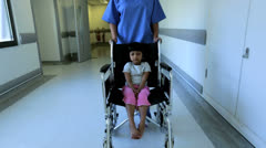 Little Girl Wheelchair Pushed Busy Hospital Corridor Stock Footage