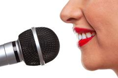 Woman speaking into a microphone Stock Photos