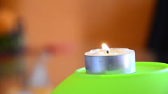 One candle and colorful background. extinguish smoking candle (works for hd) Stock Footage