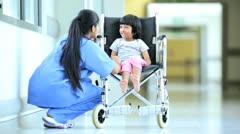 Asian Indian Nurse Talking Little Ethnic Girl Hospital Wheelchair Stock Footage