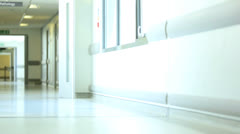 Ethnic Female Nurse Reassuring Young Child Patient - stock footage