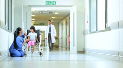 Multi Ethnic Medical Staff Child Patient Hospital Corridor Stock Footage