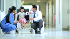 Asian Indian Nurse Paediatrician Little Ethnic Girl Hospital Wheelchair Stock Footage