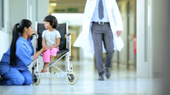 Male Asian Indian Pediatric Doctor Child Patient Hospital Corridor Stock Footage
