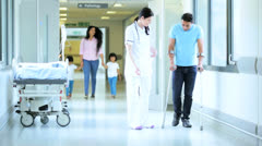 Male Patient Crutches Hospital Corridor Stock Footage