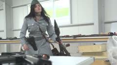 SlowMo-FemaleOfficerShoulderingRPG7-05 Stock Footage